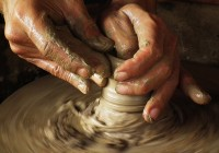 Close-up of potter turning a pot on a potter
